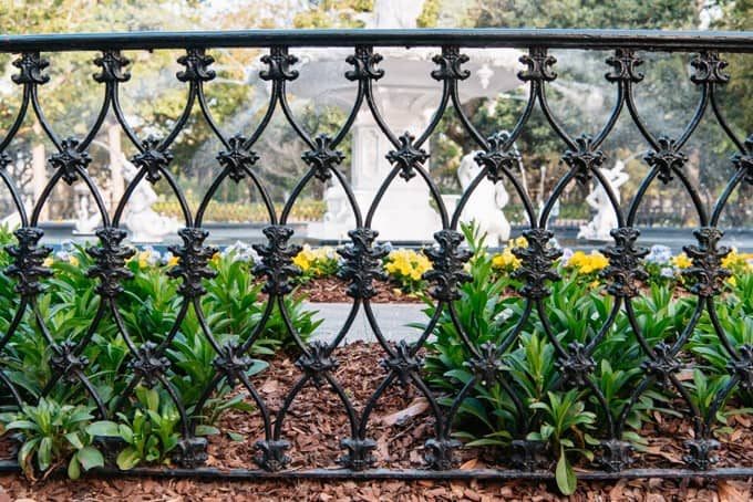An image of ornate wrought iron fencing.
