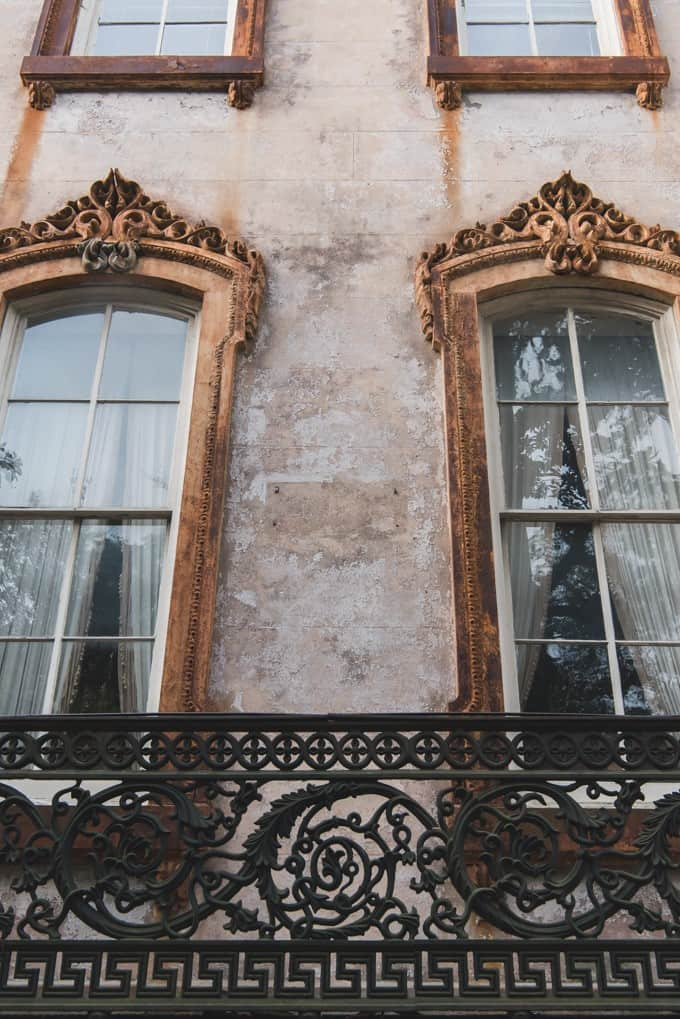 An image of the windows of an old mansion in Savannah, Georgia.