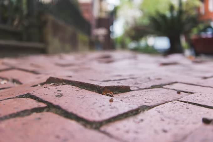 An image of uneven bricks in a sidewalk.