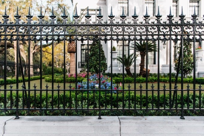 An image of an ornate wrought iron fence in Savannah, Georgia.