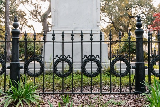An image of wrought iron wreaths on a fence in Monterey Square in Savannah, Georgia.