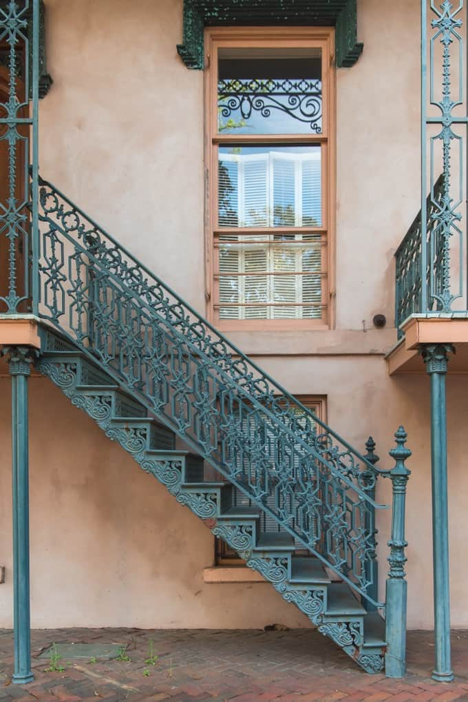 An image of a green wrought iron staircase.