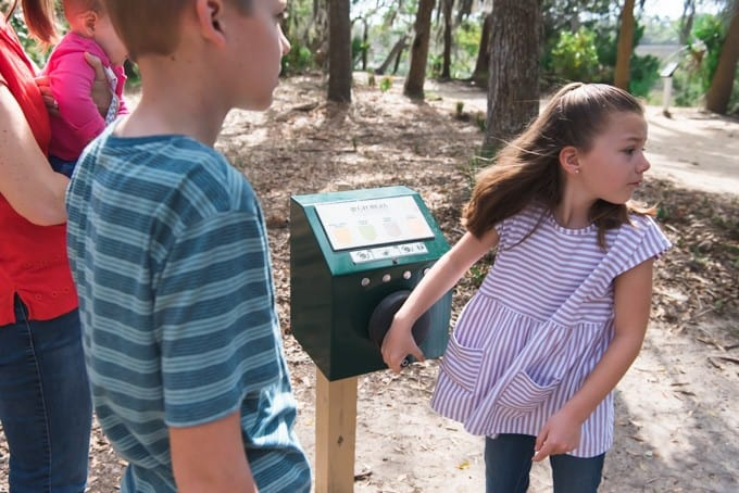 An image of an information box powered by hand at the Wormsloe Historic Site.