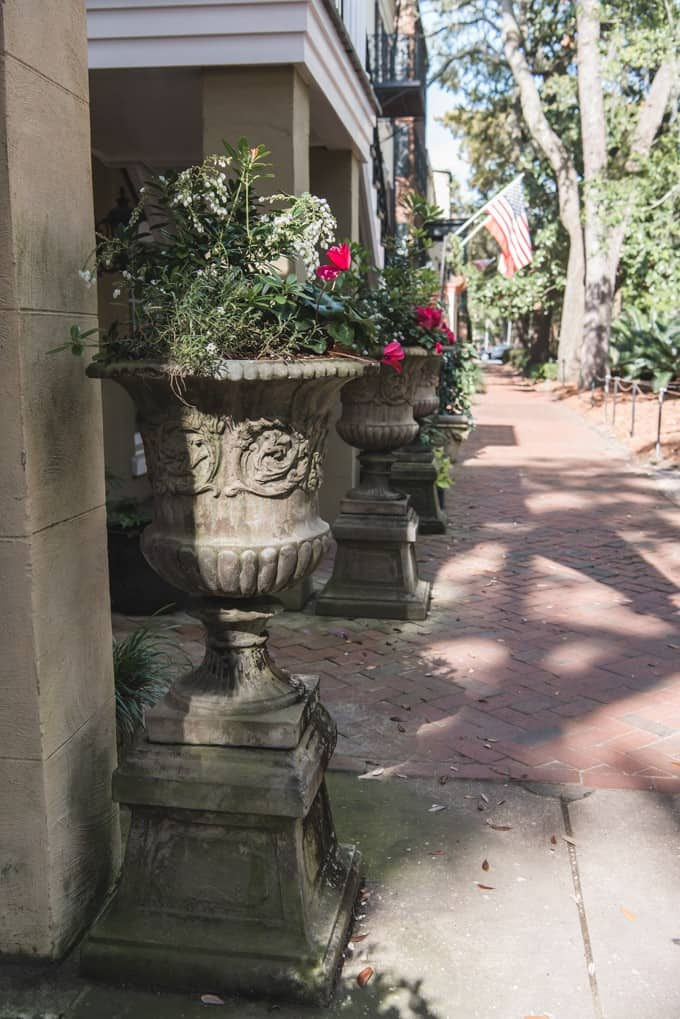 An image of decorative flower pots on a side walk in Savannah, Georgia.