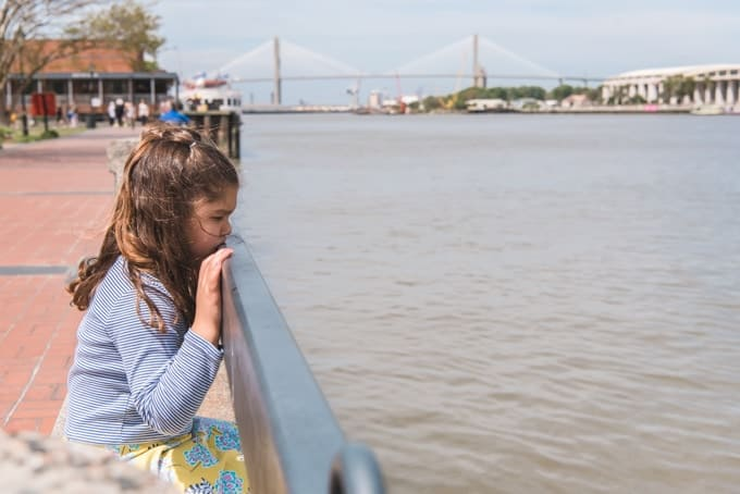An image of a girl looking at the Savannah River.