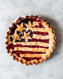 An image of an Old Glory Pie with cherry and blueberry pie fillings and the stars & stripes on top.