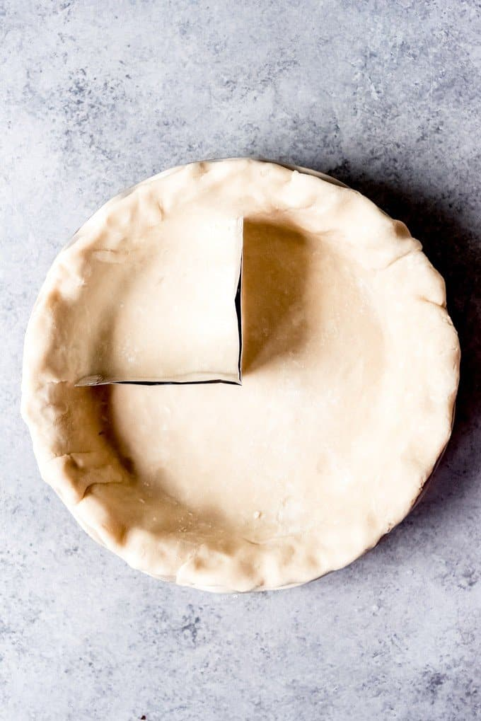 An image of a pie crust with a strip of tinfoil in it for making an American Flag pie.