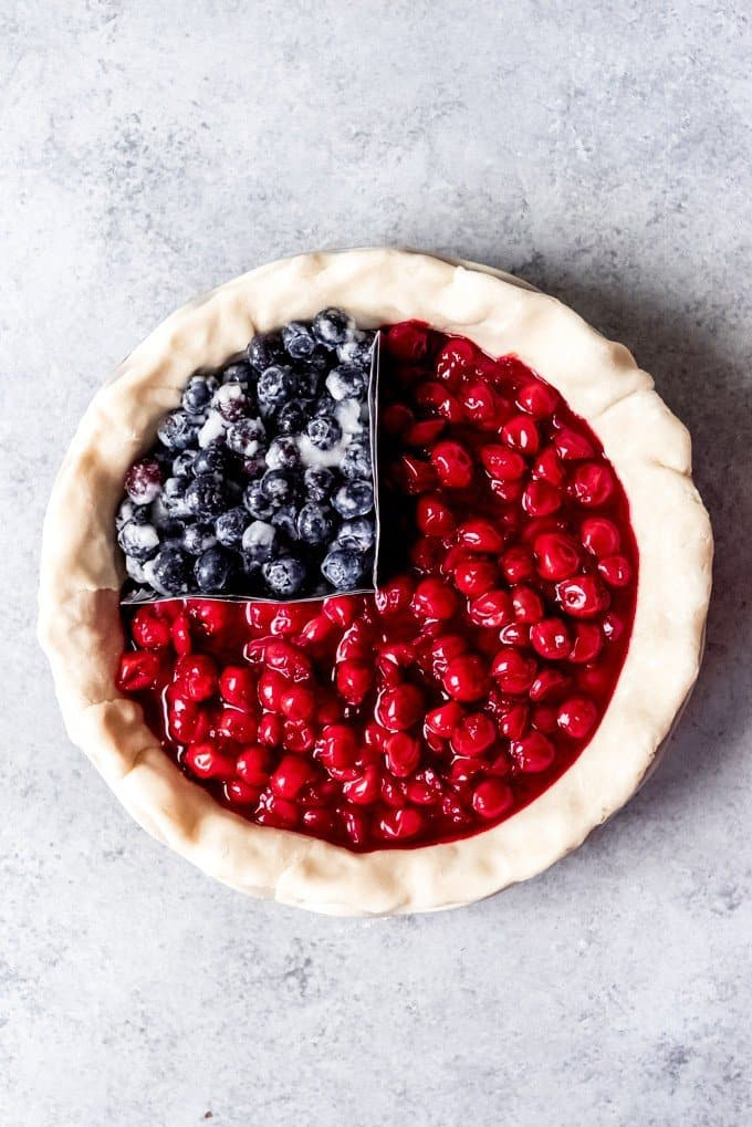 An image of a pie made with blueberry pie filling and cherry pie filling.