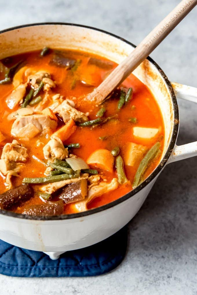 An image of a pot of Khmer red curry with chicken.
