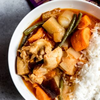 Cambodian Chicken Red Curry, known as Somlar Kari Saek Mouan or sometimes Khmer Red Curry, is a rich, flavorful curry made with coconut milk, chicken, eggplant, green beans, potatoes, sweet potatoes, and a wonderful red curry paste called kroeung.  It's similar to Thai red curry, but not as spicy.  #curry #Cambodian #recipe #dinner #ethnic #notspicy #Asian #authentic #traditional #khmer #redcurry