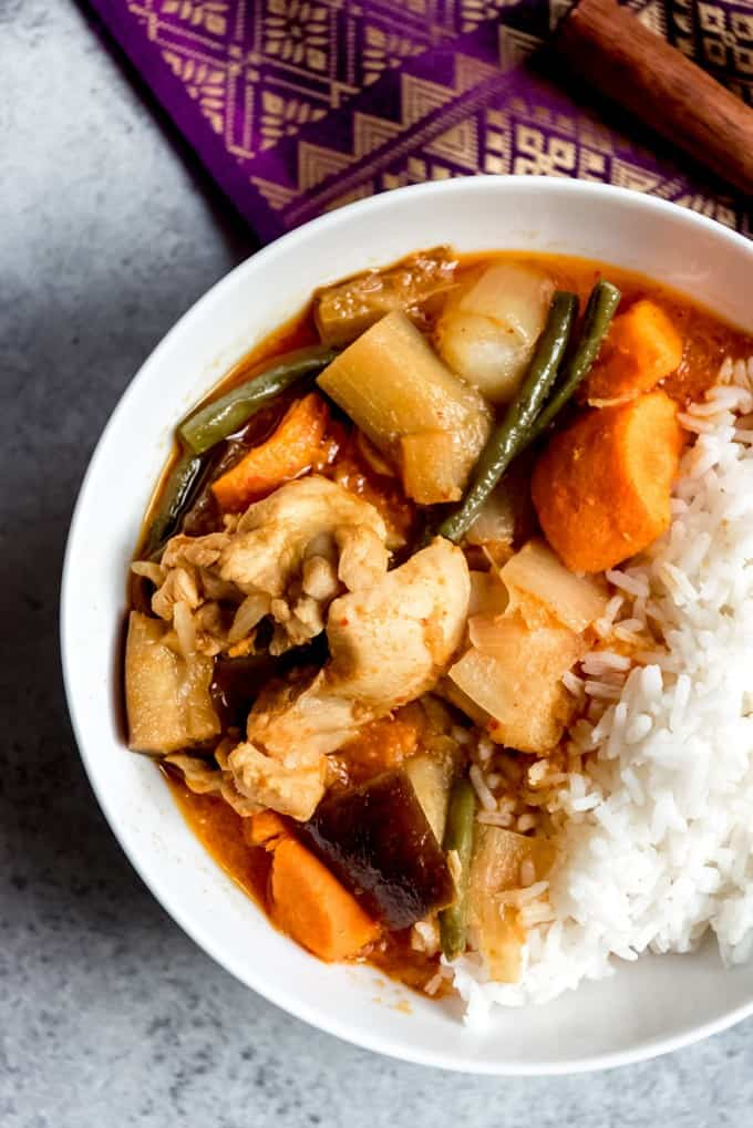An image of a bowl of chicken curry with rice.
