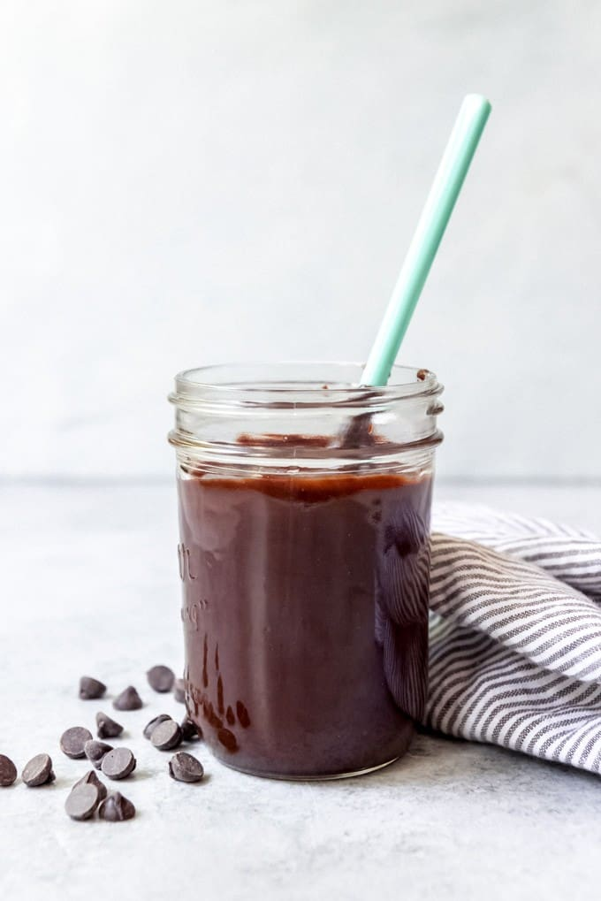 An image of a jar of homemade hot fudge topping for ice cream sundaes.