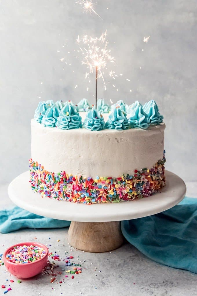 An image of a confetti birthday cake with a sparkler in it.
