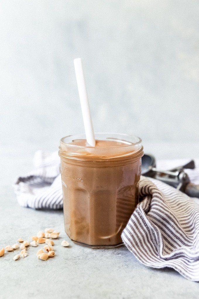An image of a jar of homemade peanut butter sauce for ice cream.