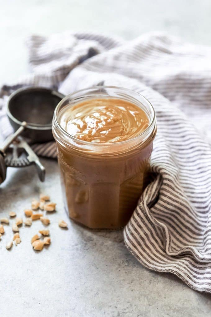 An image of a jar of homemade peanut butter sauce for topping ice cream.