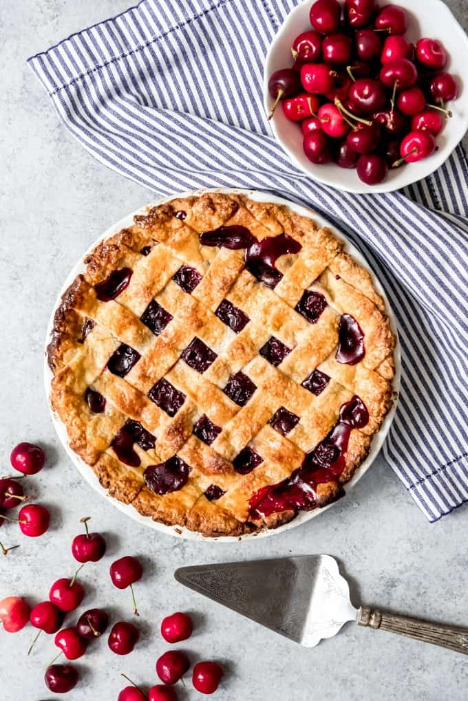 An image of a cherry pie with lattice pie crust on top.
