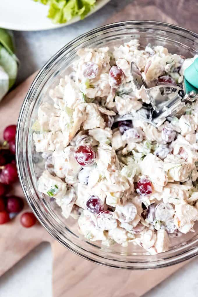 An image of a large bowl of classic chicken salad with red grapes.