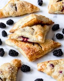 Blackberry turnovers with scattered blackberries around them