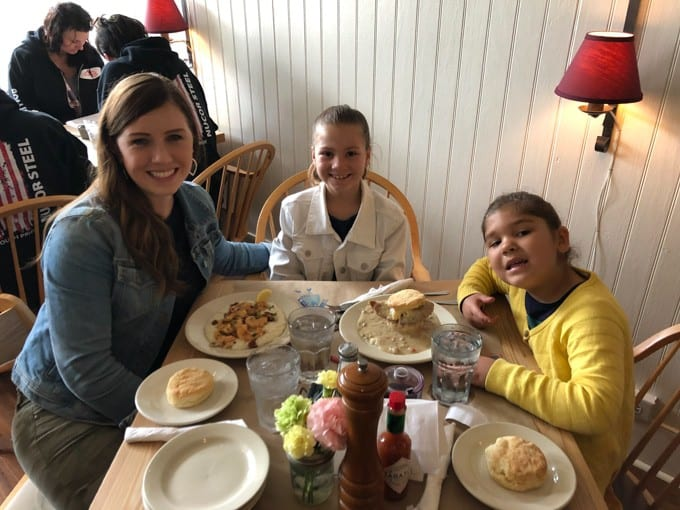 An image of a mom and her daughters eating breakfast at Hominy Grill in Charleston, South Carolina.