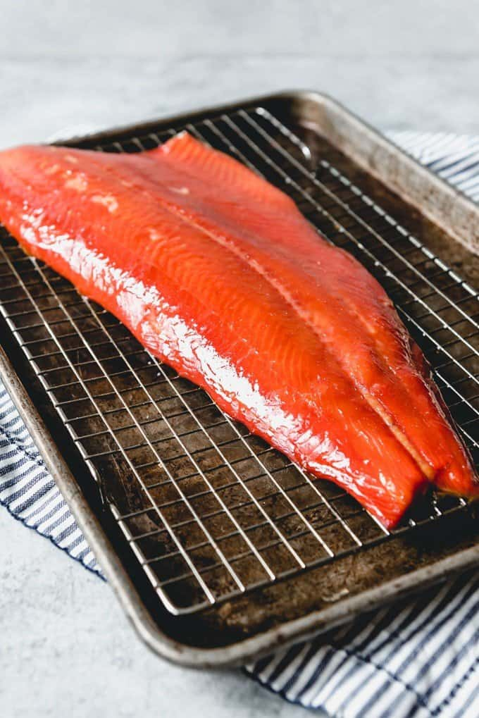 An image of a large whole piece of salmon with the skin-on that has been smoked on a Traeger pellet grill.