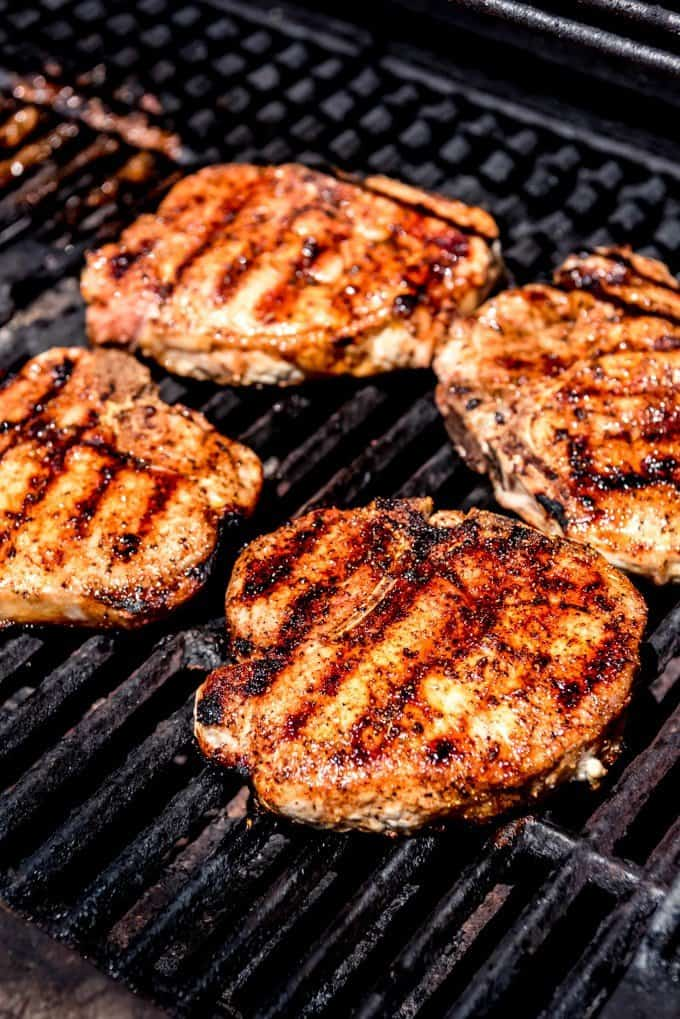 An image of pork chops on the grill.