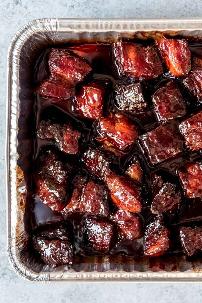 An image of smoked pork belly burnt ends in a sweet honey barbecue sauce.