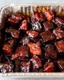An image of smoked pork belly burnt ends in a sweet honey barbecue sauce