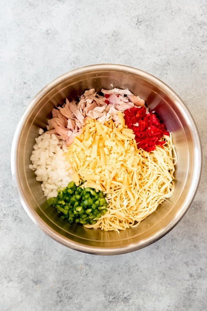 An image of the ingredients for chicken spaghetti in a bowl.