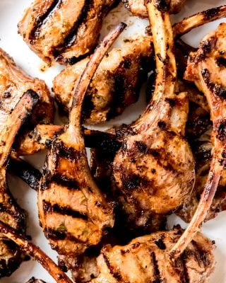 An image of close up grilled lamb chops marinated in a honey, mustard, sriracha, mayo, and mint marinade.