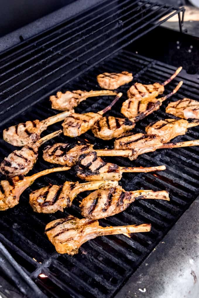 An image of marinated lamb chops on the grill.