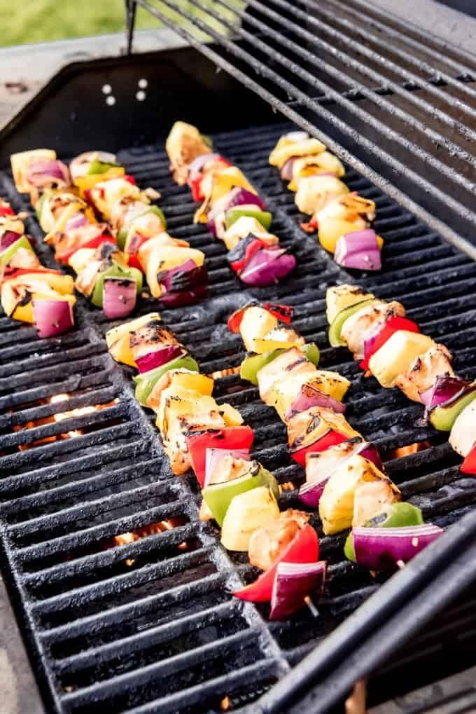 An image of Hawaiian Teriyaki Chicken Skewers on the grill.