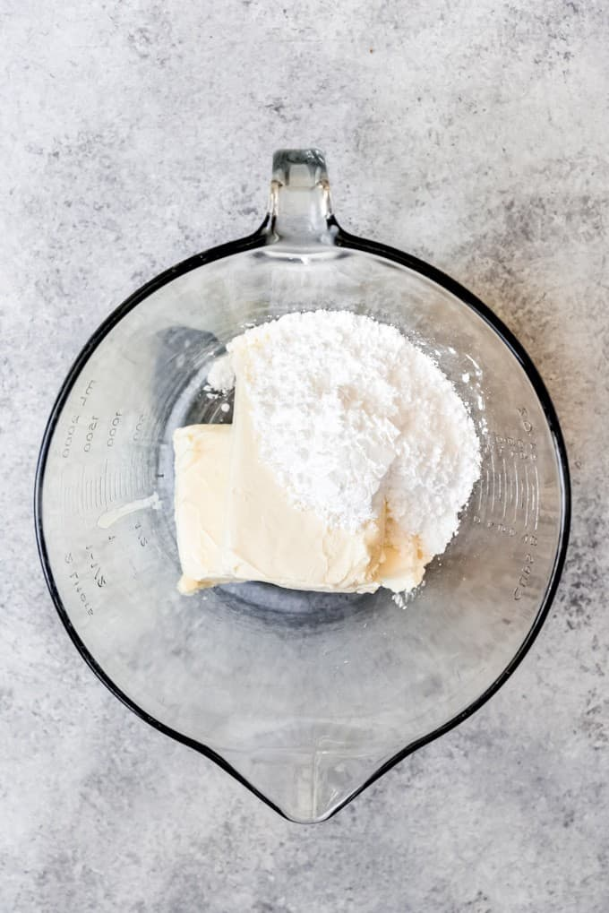 An image of cream cheese and powdered sugar in a bowl.