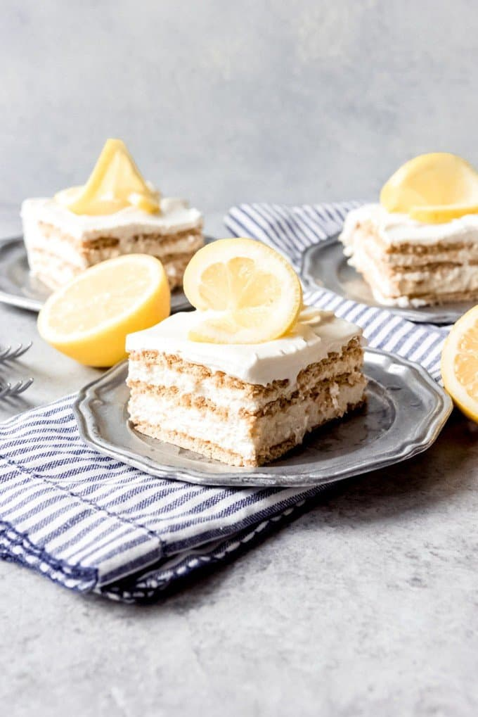 An image of a slice of lemon icebox cake on a pewter plate.