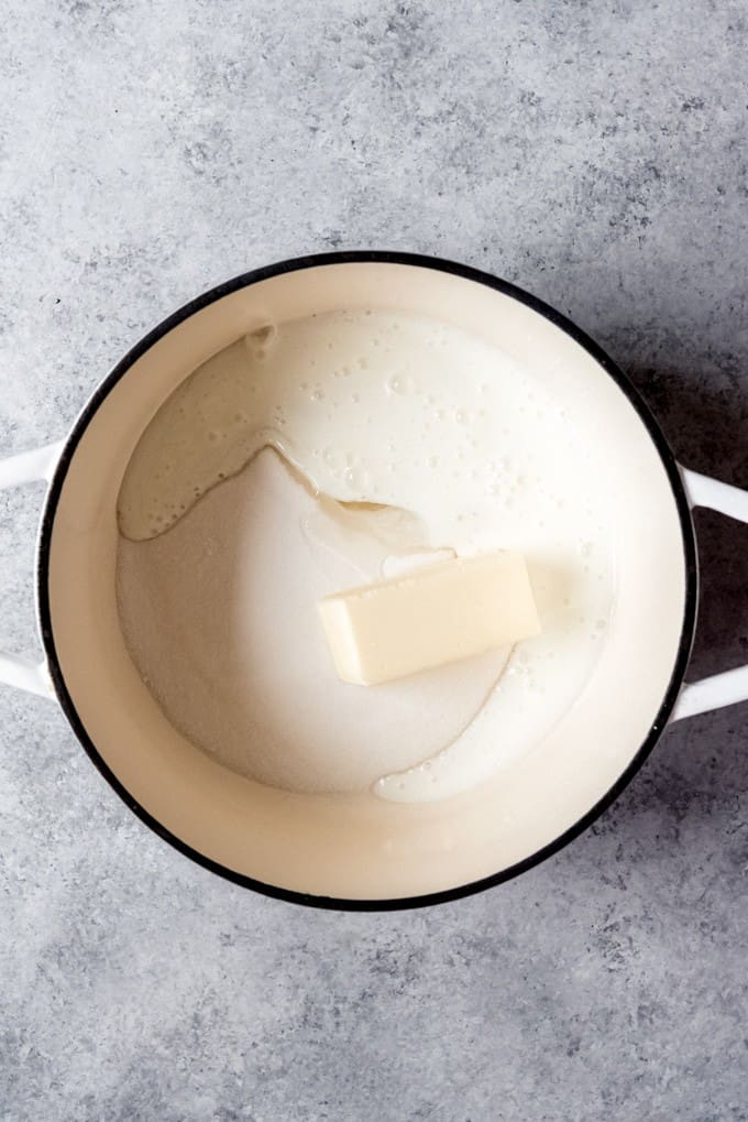 An image of butter, sugar, buttermilk, and baking soda in a large pot.