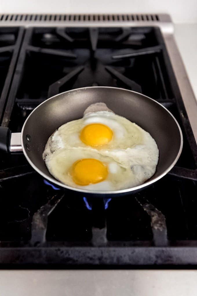 An image of two eggs in a pan.