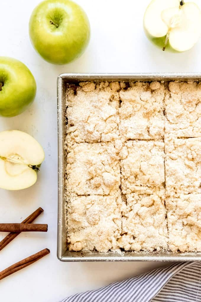 An image of a pan of German apple cake cut into squares.