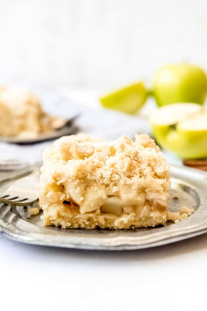 An image of a piece of German apple cake with streusel topping.