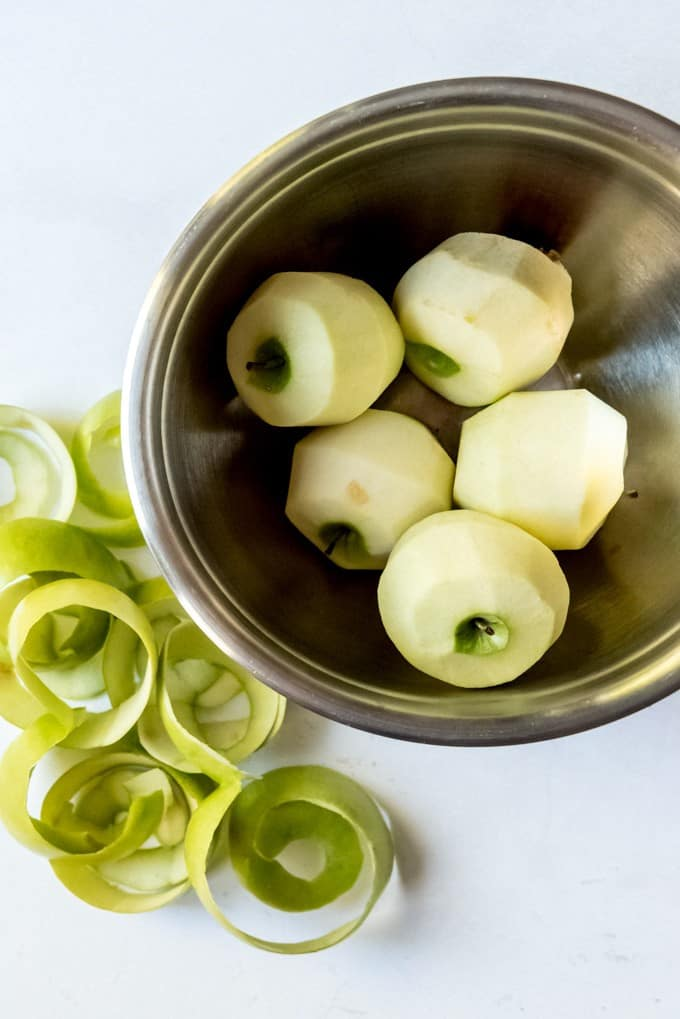 An image of peeled granny smith apples.