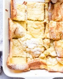 An image of a pan of German pancakes cut into squares.