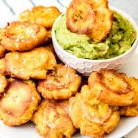 An image of a plate of crispy, salted tostones or patacones made with fried green plantains.