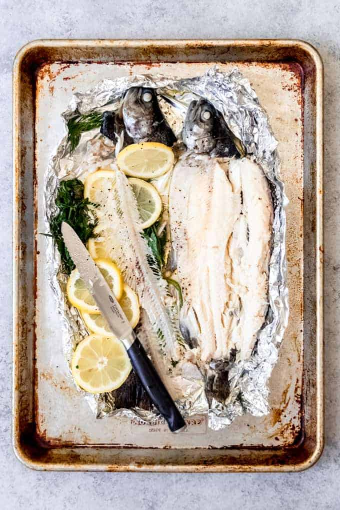 An image of baked rainbow trout with the bones removed.