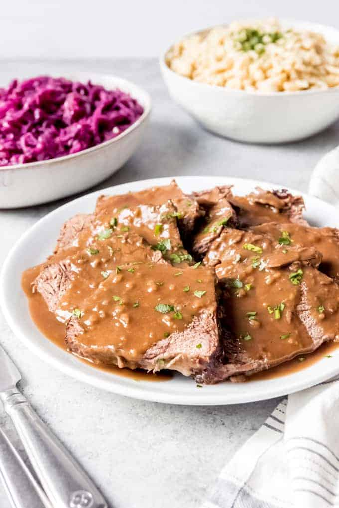 An image of traditional German sauerbraten pot roast on a plate.