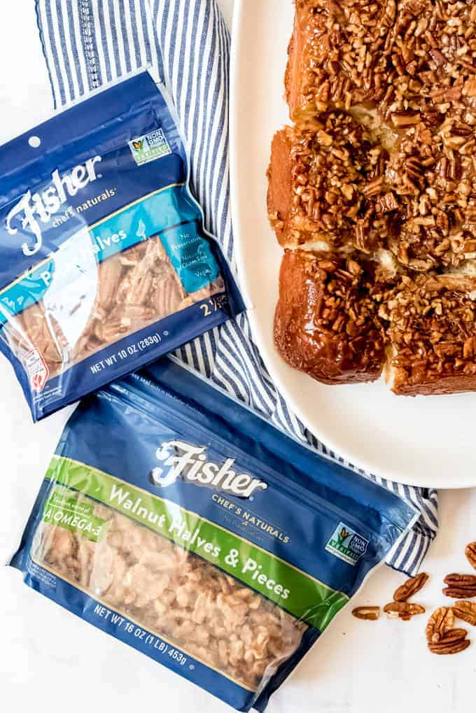 An image of two bags of Fisher pecans and walnuts next to sweet breakfast rolls.