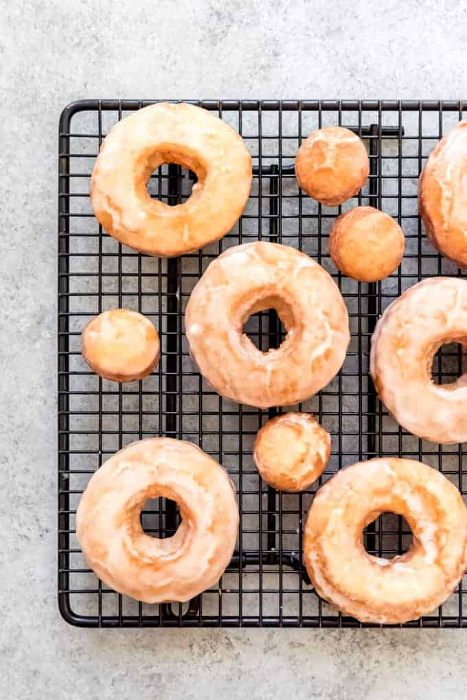 An image of old-fashioned sour cream doughnuts on a cooling rack.