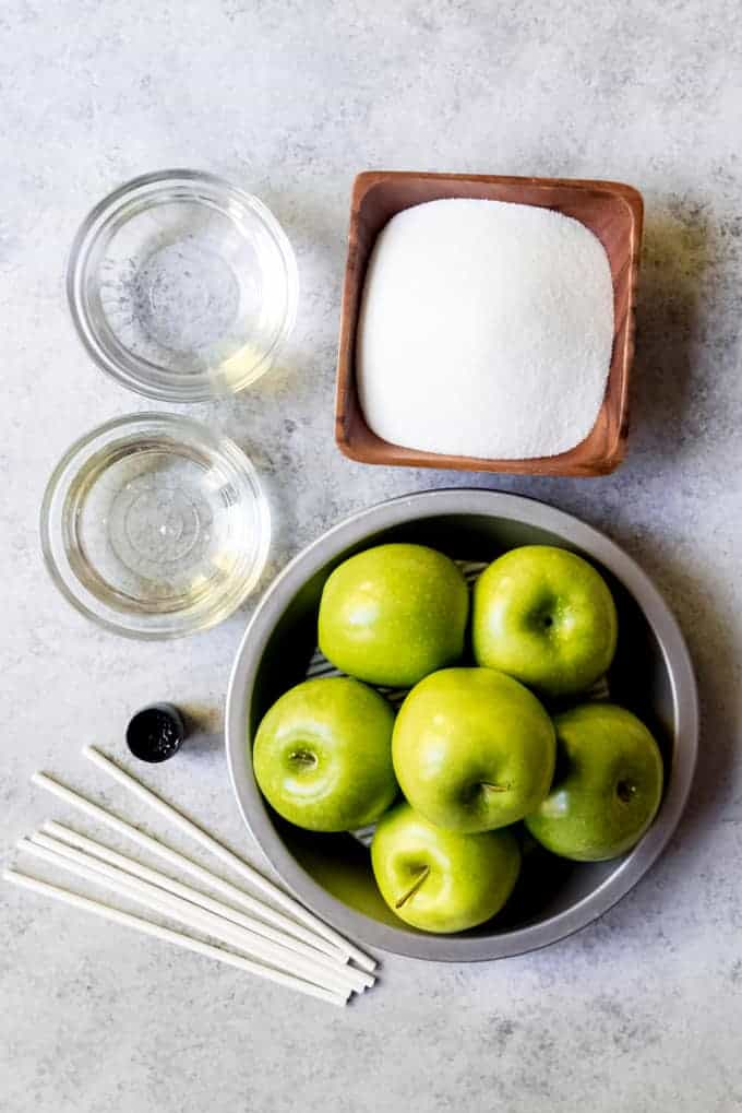 An image of the ingredients and supplied needed for making candied apples.