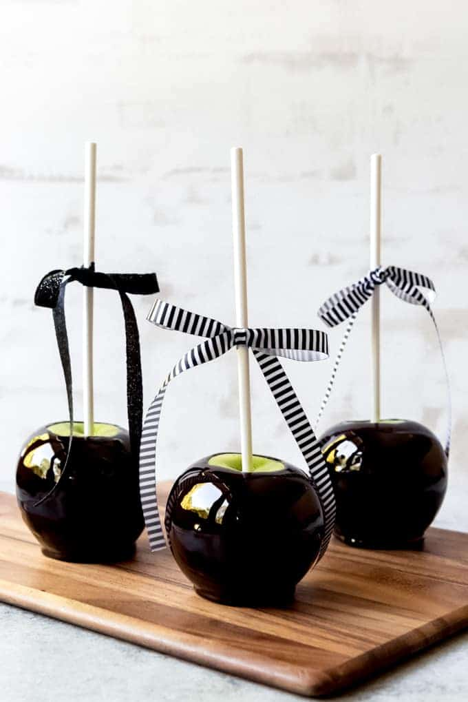 "An image of black candied ""poison"" apples for Halloween."