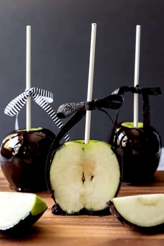 An image of Halloween candied apple sliced in half.
