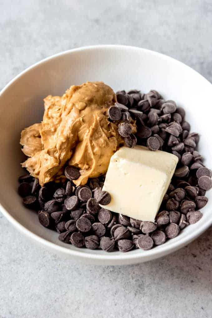 An image of peanut butter, chocolate, and butter in a bowl.