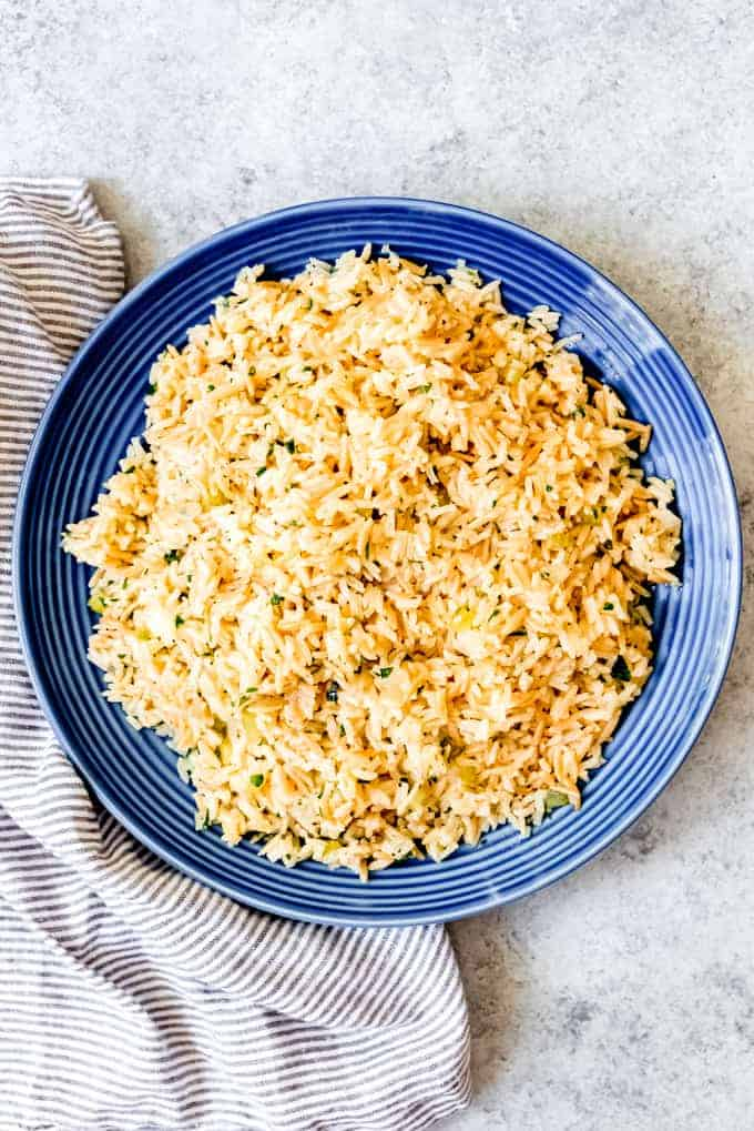 An image of a large plate of rice pilaf with celery, onion, and orzo pasta.