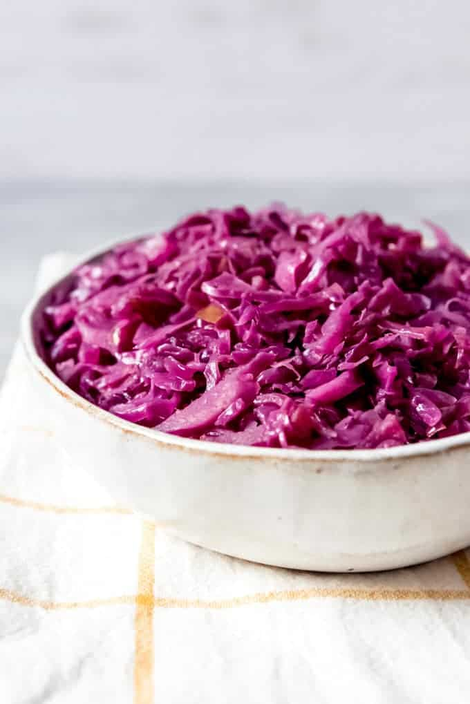 An image of a bowl filled with rotkohl (a German red cabbage recipe).